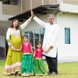 Asian Indian family outside their new home — Stock Photo #82194384