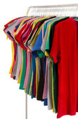 Colored shirts on hangers in a row. — Stock Photo