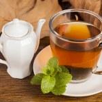 Teacup with  green tea — Stock Photo #56408737