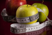 Apples with measuring tape — Stock Photo