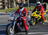 Undefined Santa delivering humanitarian aid in form of gifts to   disabled children during annual Santa Claus Motorcycle Parade on 27 December 2014 in Belgrade, Serbia — Stock Photo