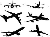 Big commercial airplanes silhouettes — Stock Vector