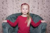 Little blond girl with mischievous face — Stock Photo