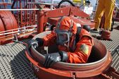 Man in chemical suit entering inside cargo tank on chemical tanker for cleaning operation — Stock Photo