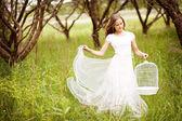 Girl with birdcage — Stock Photo