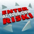 Enter at Your Own Risk 3d Words Shark Fins Circling — Stock Photo #55029299