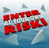 Enter at Your Own Risk 3d Words Shark Fins Circling — Stock Photo