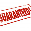 Guaranteed Word Red Ink Stamp Promise Certainty — Stock Photo #55033319