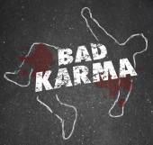 Bad Karma words on a chalk outline of a dead body — Stock Photo