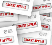 Urgent Appeal words on letters or envelopes — Stock Photo