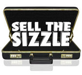 Sell the Sizzle 3d words in a black leather briefcase — Stock Photo