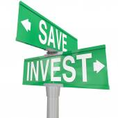 Save Vs Invest words on two way road or street signs — Stock Photo