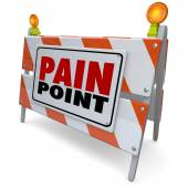 Pain Point words on road construction barrier — Stock Photo
