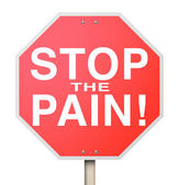 Stop the Pain words on a red stop sign — Stock Photo
