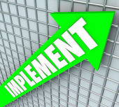 Implement word on a green arrow on a 3D grid — Stock Photo