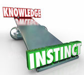 Instinct 3d word on see-saw or balance with Knowledge — Stock Photo