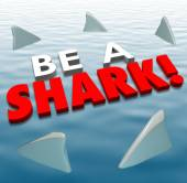 Be a Shark words in 3d letters on water with fins around it — Stock Photo