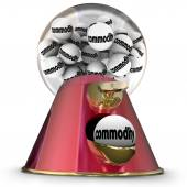Commodity word on gumballs in a machine — Stock Photo