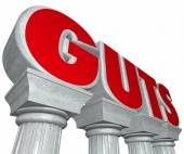 Guts word in 3d letters on marble or stone columns — Stock Photo