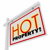 Hot Property words on home or house for sale real estate sign — Stock Photo