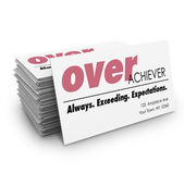 Overachiever word on a business cards — Stock Photo