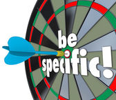 Be Specific 3D words on a dart board — Stock fotografie