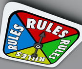 Rules word on a game board spinner to follow instructions — Stock fotografie
