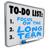 Focus on the Long Term words written on a dry erase board — Stock Photo