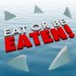 Eat or Be Eaten words on water surface — Stock Photo #61370155