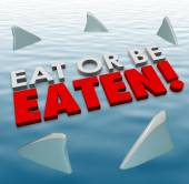 Eat or Be Eaten words on water surface — Stock Photo