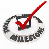 Milestone word in ring around 3d check mark — Stock Photo