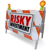 Risky Investment words on a barrier — Stock Photo