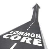 Common Core words on a road leading upward to success — Stockfoto