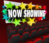 Now Showing words on a movie screen — Stock Photo