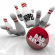 Bad Review words on a bowling ball striking pins — Stock Photo #61597907
