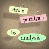 Avoid Paralysis by Analysis words in cut out papers — Stock Photo