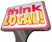Think Local words on a sign advertising community stores — Stock Photo