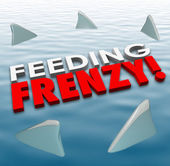 Feeding Frenzy in 3d letters on water surface with shark fins — Stock Photo