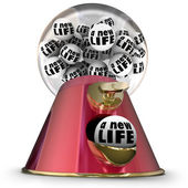 A New Life word on gum balls in a machine or dispenser — Stock Photo