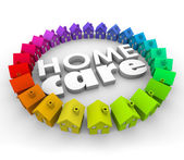 Home Care words in 3d letters surrounded by houses — Stock Photo
