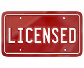 Licensed word on red auto vehicle license plate — Stock Photo
