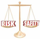 Risk Vs Safety 3d words on a gold scale — Stock Photo