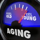 Aging word on a gauge — Stock Photo