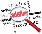 Magnifying glass on the word Redefine — Stock Photo