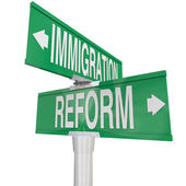 Immigration Reform words on two way road signs — Stock Photo