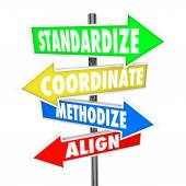 Standardize, Coordinate, Methodize and Align words on arrow signs — Stock Photo