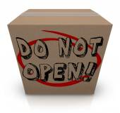 Do Not Open words on a cardboard box — Photo