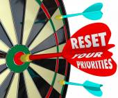 Reset Your Priorities words on a dart board — Stock Photo