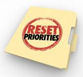 Reset Priorities words stamped on a manila folder — Stock Photo