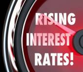 Rising Interest Rates words on a speedometer — Stock Photo